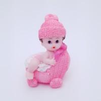 Figurina bebelus fetita in carucior